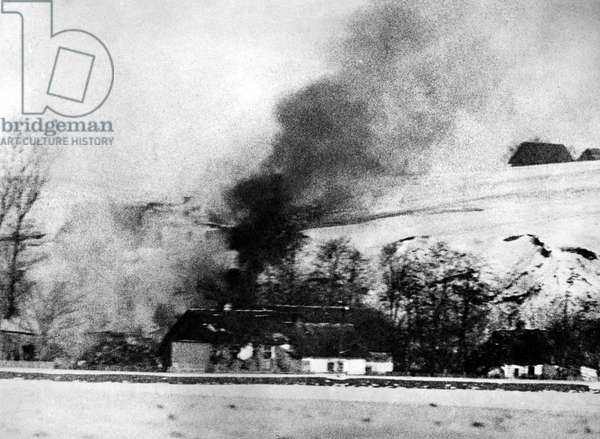 A house on the Eastern Front that was set on fire, 1945 (b/w photo)