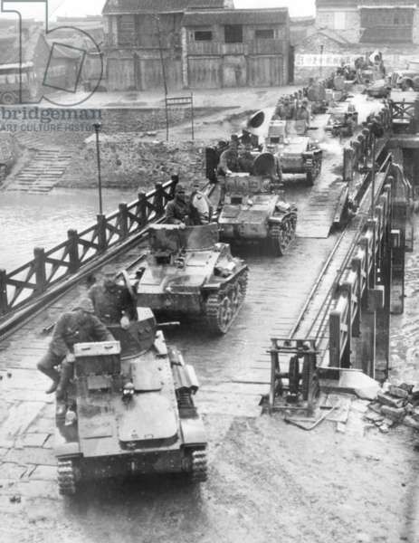 Japanese tanks crossing a river in China, during the Second World War (b/w photo)