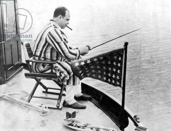Al Capone during fishing, 1930 (b/w photo)