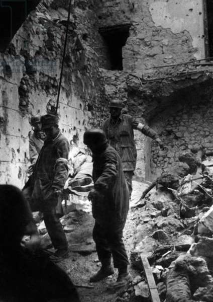 Transportation of a wounded man at Monte Cassino, 1944 (b/w photo)