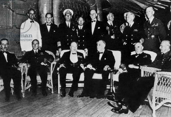 Group portrait showing Winston Churchill, Franklin D. Roosevelt, and General George C. Marshall on board the battleship 'Augusta' at the Atlantic Charter Conference, Newfoundland, 9th August 1941 (b/w photo)