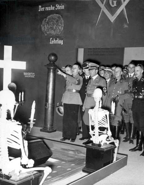 """A group of NSDAP officials guided by Wuester, the project manager of the exhibition, at the opening of the propaganda exhibition """"The Eternal Jew"""", Munich, Bavaria, November 1937, (b/w photo)"""