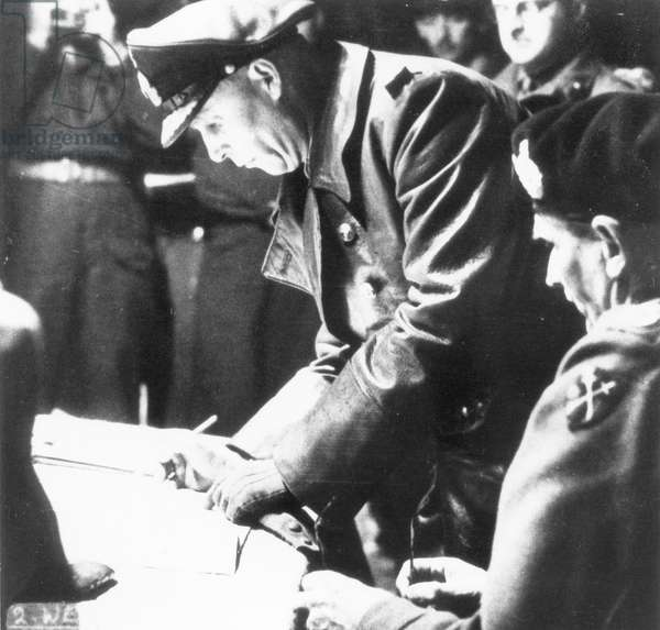 Hans Georg von Friedeburg signing the surrender of the Wehrmacht in Northern Europe in General Montgomery's headquarter, 4th May 1945, (b/w photo)