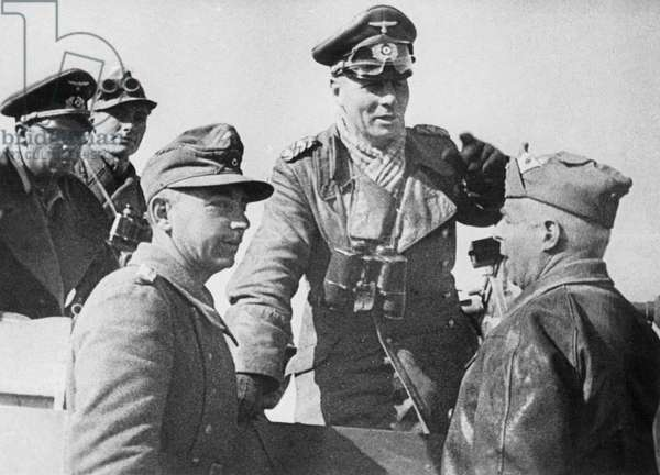 Erwin Rommel with officers at a meeting in the desert, 1942 (b/w photo)