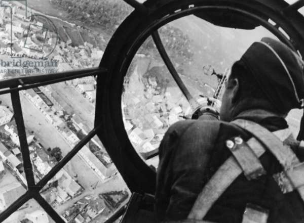 A bombadier in a Heinkel He 111 bomber, during the invasion of Poland, 1939 (b/w photo)
