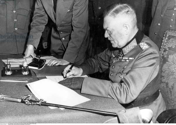 General field marshall Wilhelm Keitel signing the unconditional surrender on behalf of the Wehrmacht in the headquarter of the soviet army in Berlin in Berlin-Karlshorst,  8th May 1945 (b/w photo)