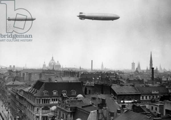 """The airships LZ 129 """"Hindenburg"""" and LZ 127 """"Graf Zeppelin"""" over Berlin, 1936 (b/w photo)"""