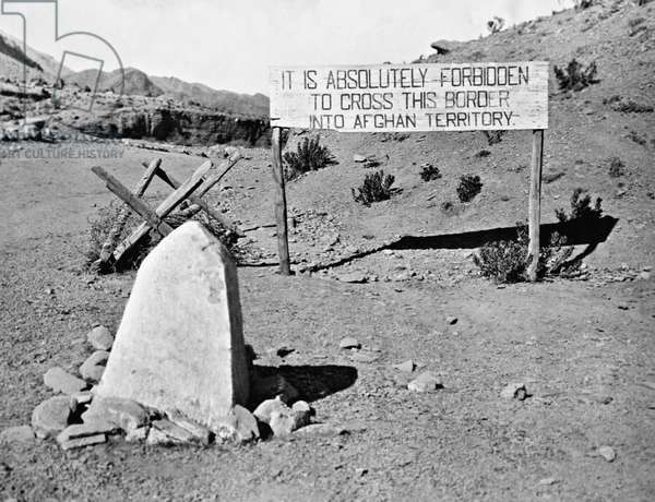 A sign in the Waziristan region marks the border between India and Afghanistan, prohibiting entry into Afghan territory, 1928 (b/w photo)
