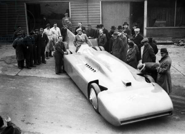 Sir Malcolm Campbell in his racing car Bluebird at Brooklands, 1935 (b/w photo)