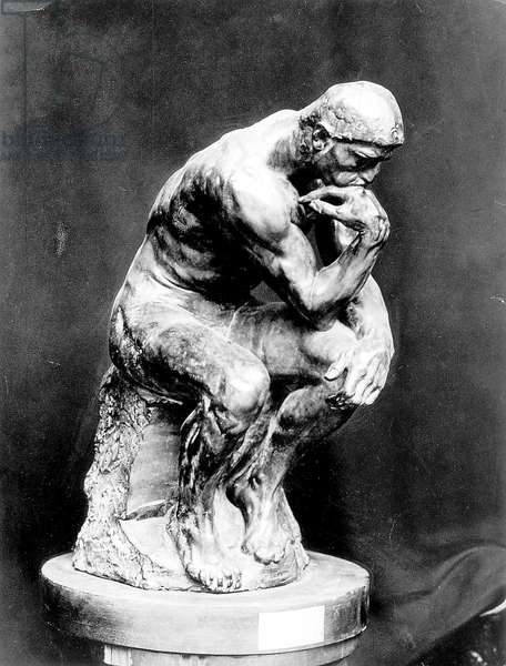 Bronze sculpture The Thinker by Auguste Rodin (b/w photo)