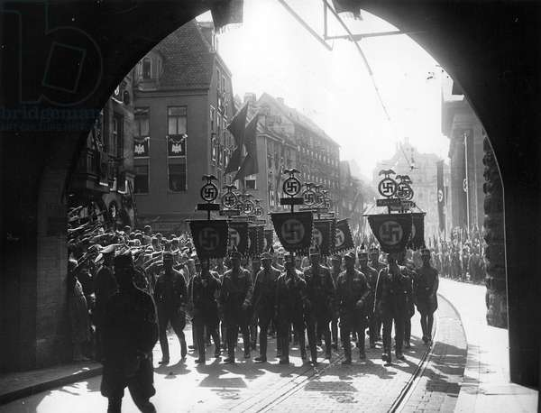 March of an SA formation through Nuremberg to the Nazi Party Rally, 1936 (b/w photo)