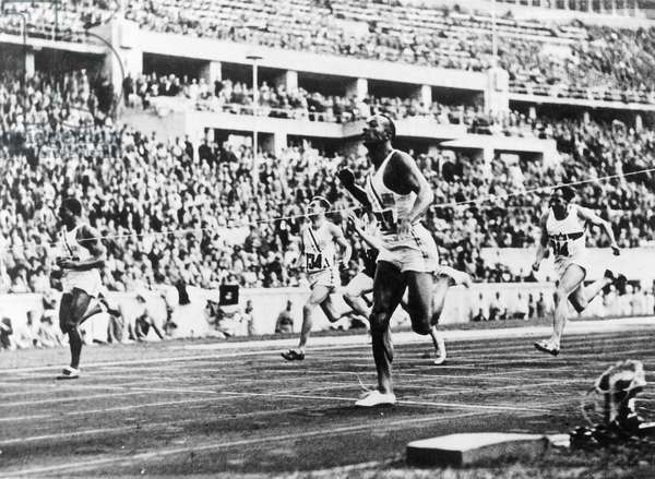 Jesse Owens during the Olympic Games in Berlin, 1936 (b/w photo)