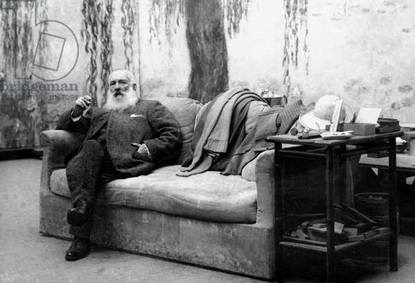 Claude Monet in his studio, Giverny, c.1910-26 (b/w photo)