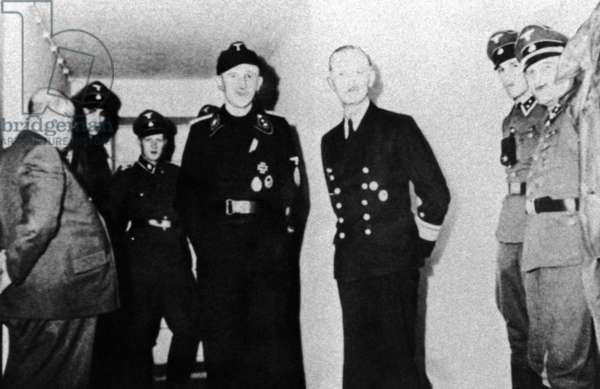 Dr. Theo Morrell and bunker guards in the Führerbunker, 1945 (b/w photo)