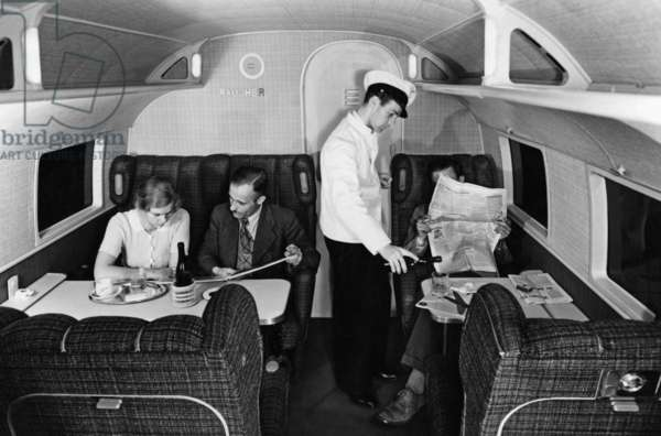 """Smoking compartment aboard the """"Condor"""" of the Lufthansa, 1937 (b/w photo)"""