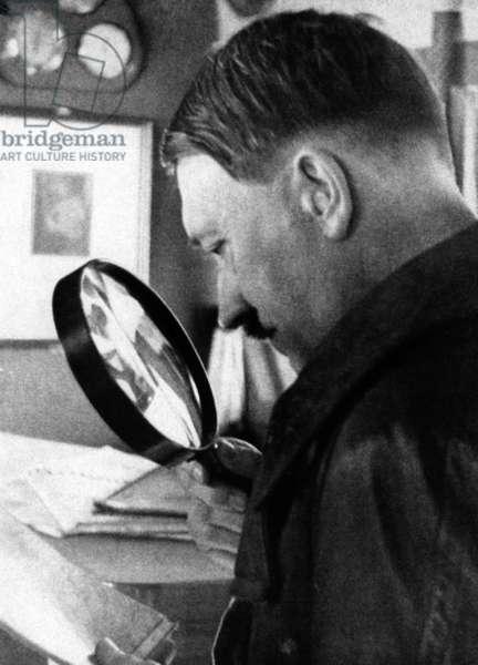 Adolf Hitler studies a map of Austria, 1938 (b/w photo)