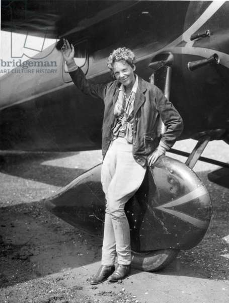 Amelia Earhart in front of her airplane, 1932 (b/w photo)