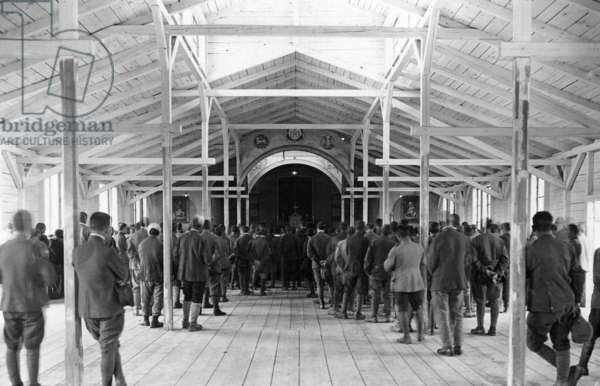 Italian soldiers inside a church in a prisoner of war camp, 1918 (b/w photo)