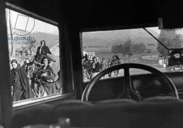 Civil war refugees on a country road, 1936-39 (b/w photo)