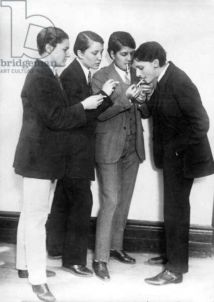 A group of women wearing men's suits and smoking, 1921 (b/w photo)