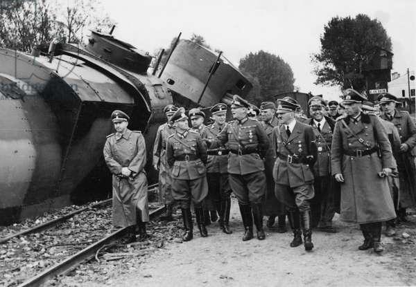Adolf Hitler and senior Nazi figures inspecting a destroyed Polish tank train, September 1939 (b/w photo)