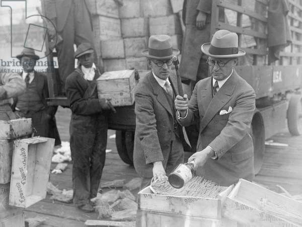 Destruction of alcohol during Prohibition in the United States, 1924 (b/w photo)