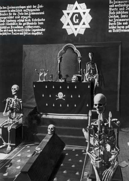 Exhibition 'The Eternal Jew', a Masonic lodge surrounded by skeletons, Munich, 1937 (b/w photo)