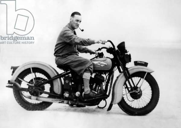 Sir Malcolm Campbell on a motorcycle, 1935 (b/w photo)