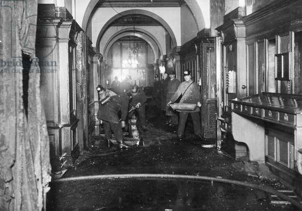 Firefighters during cleanup efforts in the Reichstag in Berlin, 1933 (b/w photo)