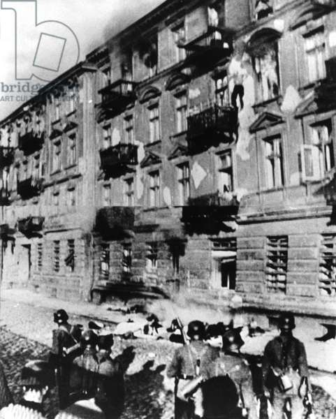 A resistance fighter jumps out of the window during the uprising in the Warsaw Ghetto, 1943 (b/w photo)
