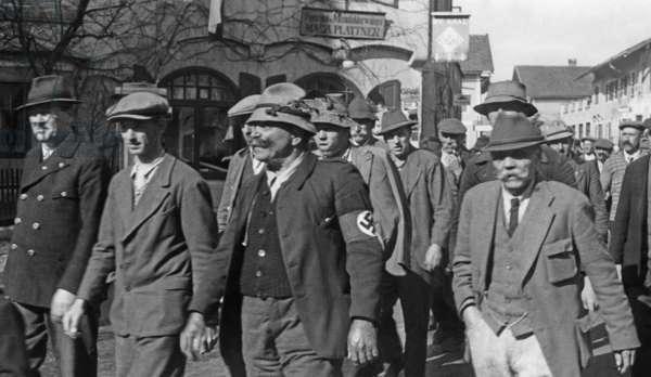 Austrians with swastika armband, 1938