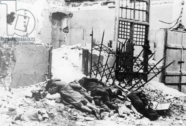 Dead bodies during the Warsaw Ghetto Uprising, 1943 (b/w photo)