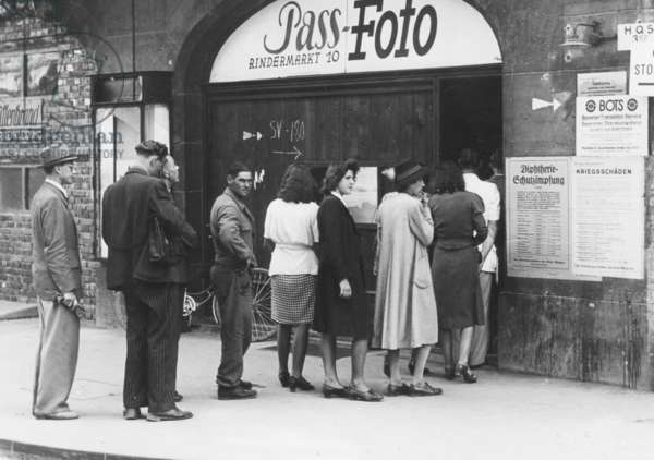 Standing in line for new photos, 1945