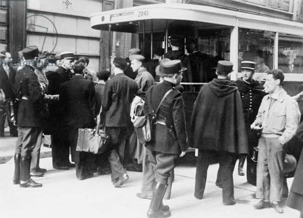 French police and German soldiers arresting Jews for deportation, Paris, August 1941 (b/w photo)