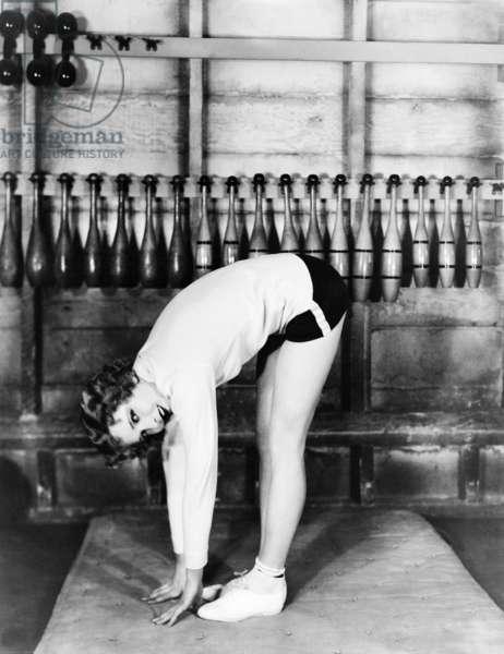 Jean Arthur at the gym (b/w photo)