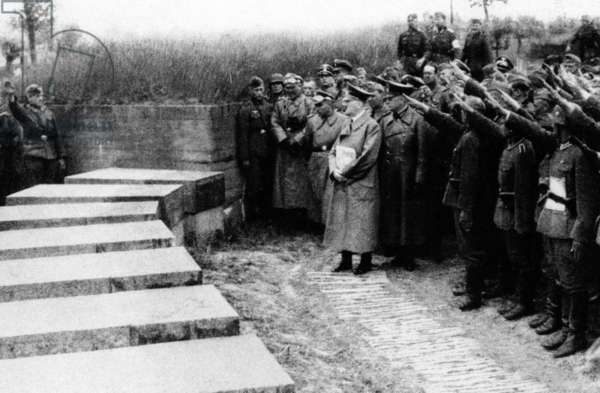 Adolf Hitler with his followers at the cemetery of Langemarck, 1940 (b/w photo)