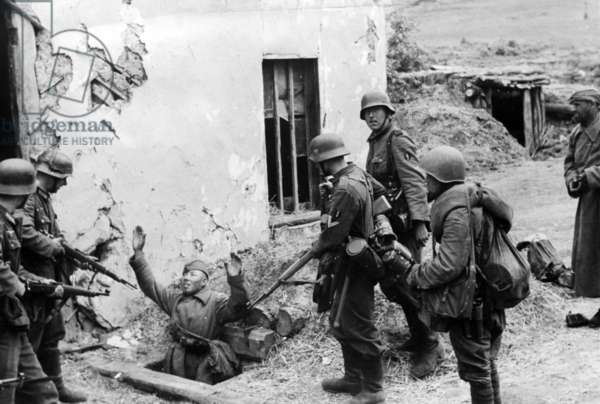 German soldiers surround a surrendering member of the Red Army, May 1942 (b/w photo)