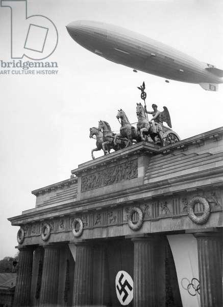 Zeppelin-Airship 'Hindenburg' (LZ129) over the Brandenburg Gate, 1st August1936 (b/w photo)