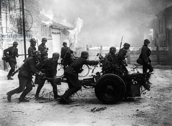German infantry bring a 3.7 cm-PaK 36 into position during the battles around Dunkirk, France, 4th June 1940 (b/w photo)