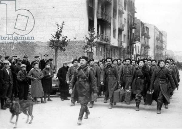 Polish soldiers march into imprisonment, 1939 (b/w photo)