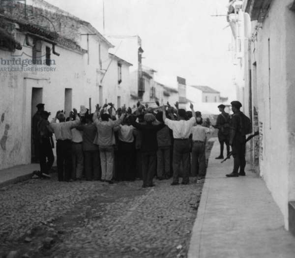 Republican fighters surrender to Spanish national soldiers, Seville, 1936