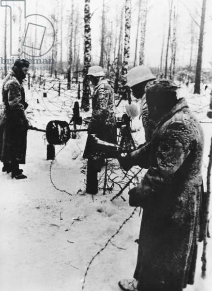 German soldiers lay wire on the eastern front, 1942