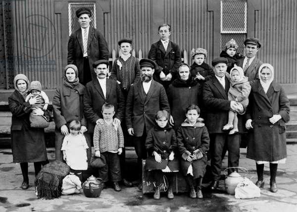 Russian immigrant family in Ellis Island, 1929 (b/w photo)