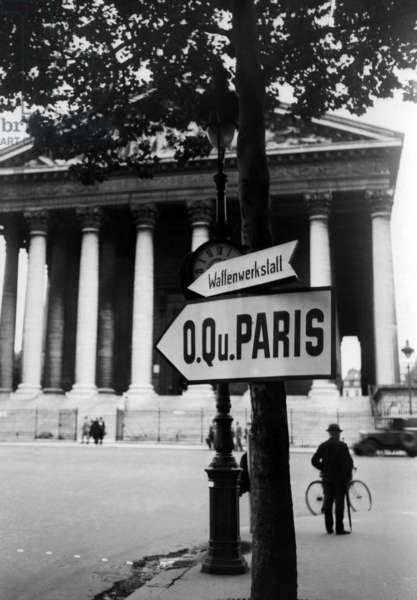 Tree with signs in front of La Madeleine in Paris, 1940 (b/w photo)