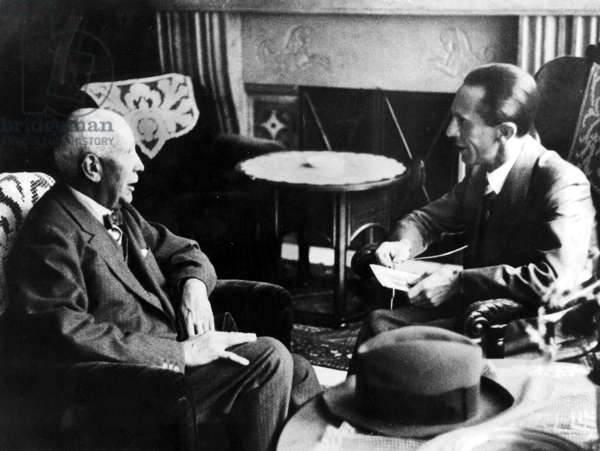 Richard Strauss, the President of the Reich Music Chamber speaking with Joseph Goebbels in the Hotel Bellevue in Dresden, 1935 (b/w photo)