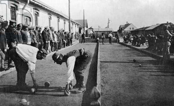 Italian prisoners of war play boccia, 1918 (b/w photo)