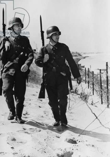 Patrol of the Wehrmacht on the Atlantic Wall, 1942 (b/w photo)