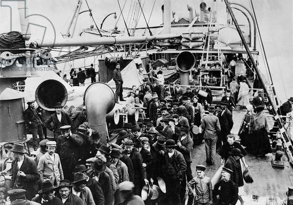 Emigrants on the deck of the passenger ship 'Imperator' on the journey to America, 1913 (b/w photo)