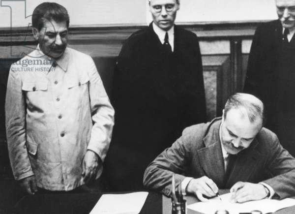 Molotov signing the Molotov-Ribbentrop Pact, 23.8.1939 (b/w photo)