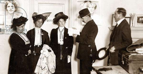 Mrs. Drummond, Mrs. Pankhurst and Miss Christabel Pankhurst at a police station in London, October 1908 (b/w photo)